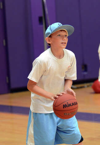 Jack Palmer, 10, of Stamford, shoots hoops during Peak Performance All Sports Camp at Westhill High School in Stamford on Wednesday, Aug. 15, 2012. The camp offers a combination of traditional sports games, physical education activities, and cooperative games for boys and girls ages 4-12. Photo: Amy Mortensen / Connecticut Post Freelance