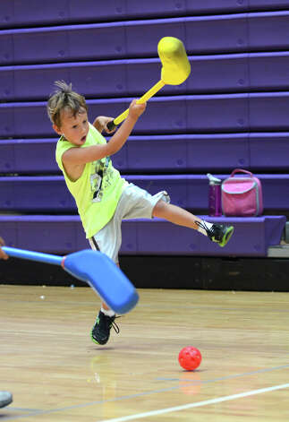 A camper plays floor hockey during Peak Performance All Sports Camp at Westhill High School in Stamford on Wednesday, Aug. 15, 2012. The camp offers a combination of traditional sports games, physical education activities, and cooperative games for boys and girls ages 4-12. Photo: Amy Mortensen / Connecticut Post Freelance