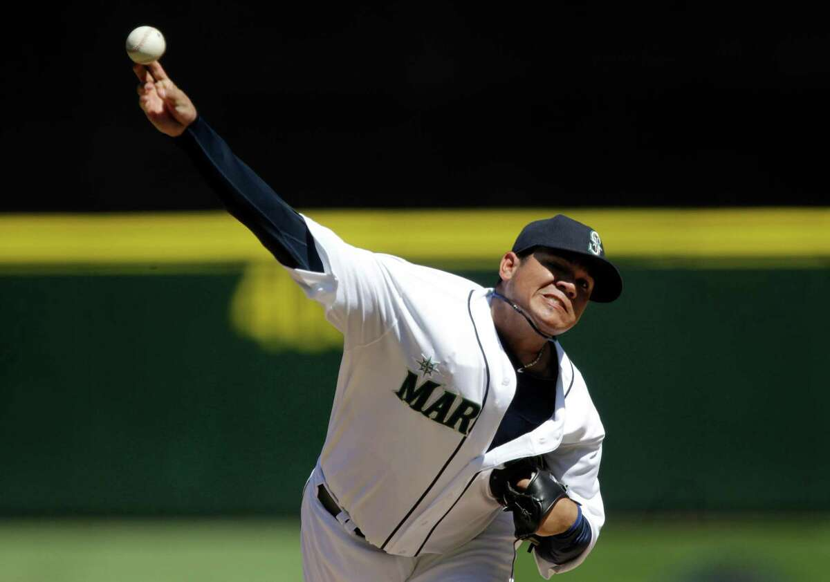 Seattle Mariners starting pitcher Felix Hernandez throws to a Tampa Bay Rays batter in the fourth inning of a baseball game,Wednesday in Seattle. (AP Photo/Ted S. Warren)