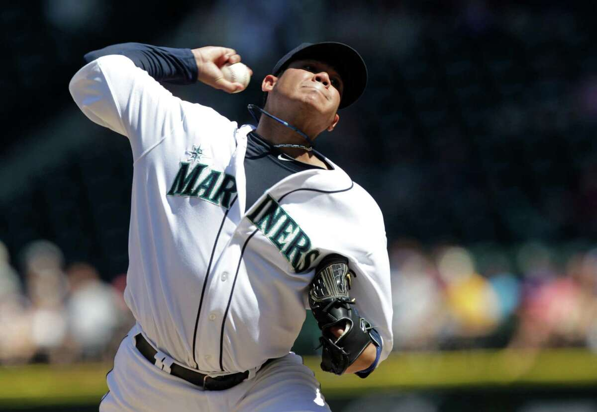 Seattle Mariners starting pitcher Felix Hernandez throws against the Tampa Bay Rays in the fifth inning of a baseball game on Wednesday in Seattle. (AP Photo/Ted S. Warren)