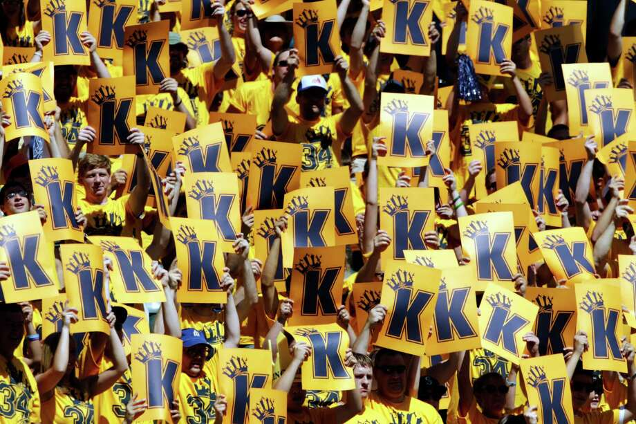 """Fans in a special section for Seattle Mariners starting pitcher Felix Hernandez cheer and hold up """"K"""" cards for strikeouts on Wednesday. (AP Photo/Ted S. Warren) Photo: Ap/getty"""