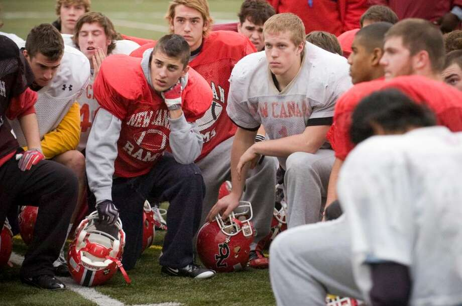 The New Canaan Rams gather around athletic director Jay Egan (not pictured) as he give a pep talk during football practice at New Canaan High School in New Canaan, Conn. on Thursday, Dec. 3, 2009. The Rams will play for a repeat of the state title on Saturday. Photo: Chris Preovolos / Stamford Advocate