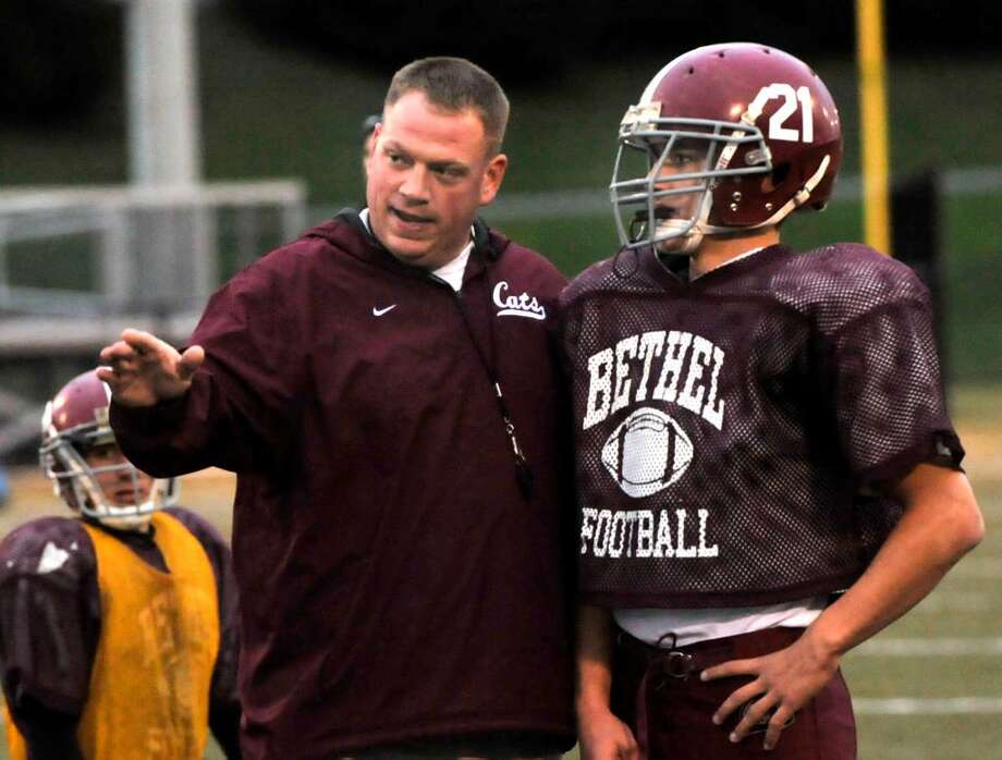 Jason Gill, Bethel High Football Head Coach,talks to Brandon Schmidt, during practice at Memorial Stadium in Waterbury on Thursday, Dec.3,2009. Photo: Michael Duffy / The News-Times