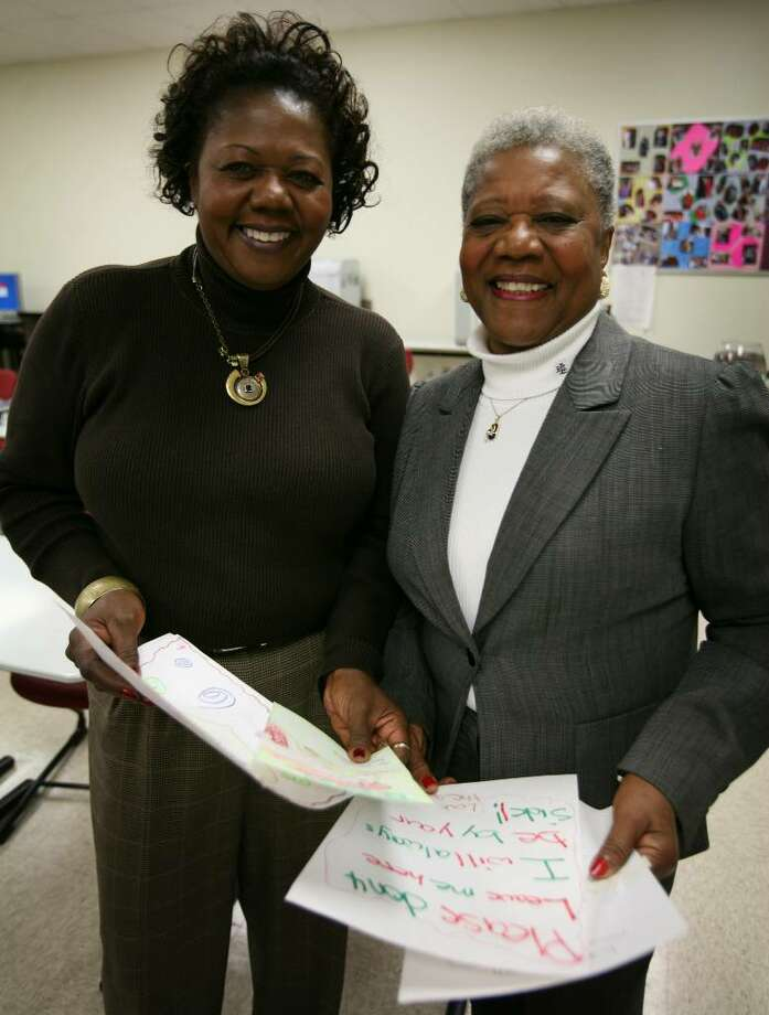 "Assistant Supt. of Schools Denise Clemons, left and her mother Barbara Clemons recently participated in a door-to-door ""No Excuses"" campaign to get students to return to school. Barbara Clemons used artwork and writings that she had saved from one former student to convince him to return. Photo: Brian A. Pounds / Connecticut Post"