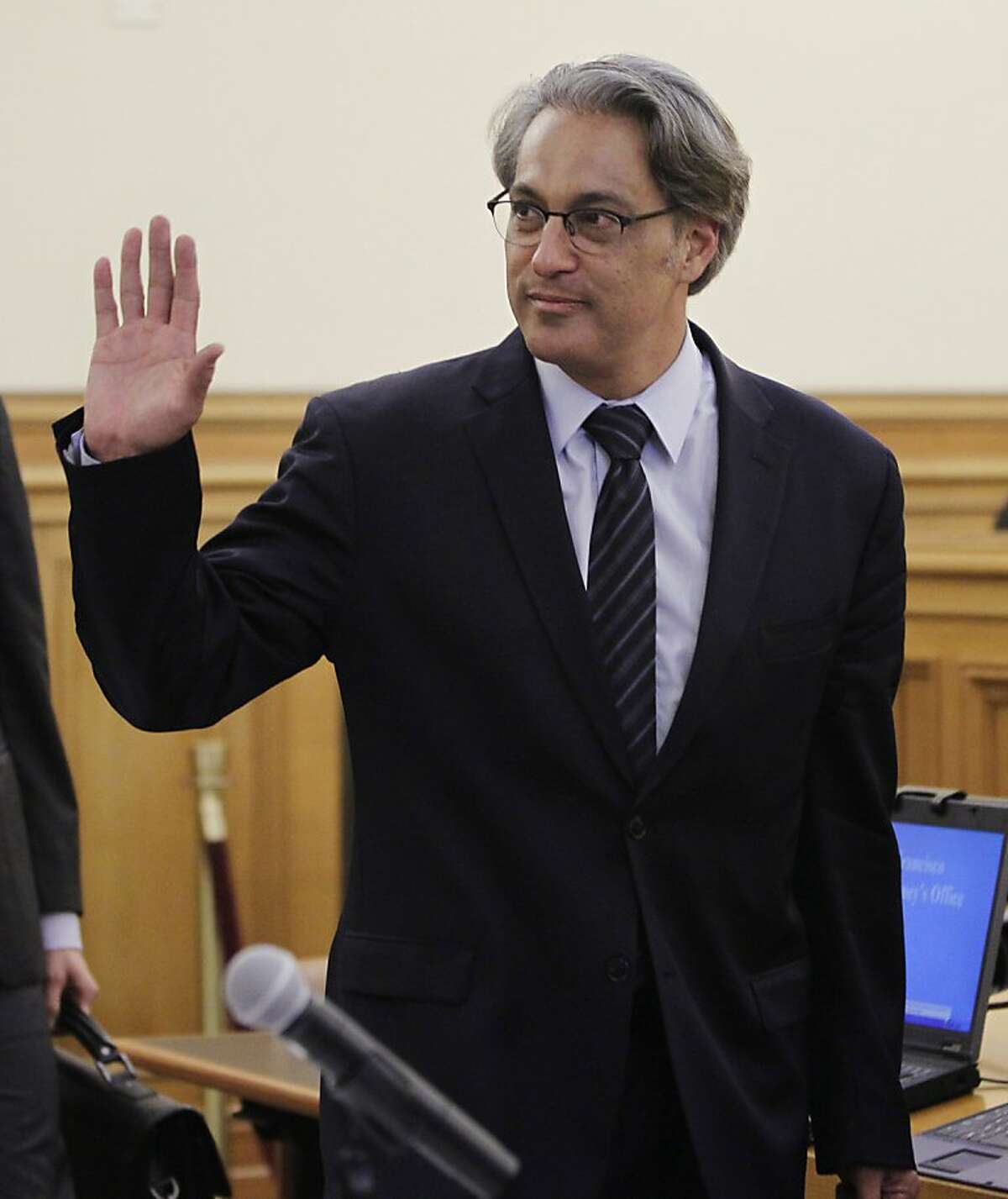 FILE - In this July 18, 2012 file photo, San Francisco Sheriff Ross Mirkarimi waves as he arrives for his misconduct hearing in San Francisco. The decision on whether the San Francisco sheriff is fit to serve after a domestic violence conviction takes a big step forward when a city ethics panel issues its recommendation. Before it makes its recommendation late Thursday Aug. 16 to the Board of Supervisors, which has final say on the matter, the San Francisco Ethics Panel is scheduled Thursday to hear closing arguments from lawyers representing Mirkarimi and Mayor Ed Lee, who is trying to remove the sheriff from office. (AP Photo/Paul Sakuma, File)