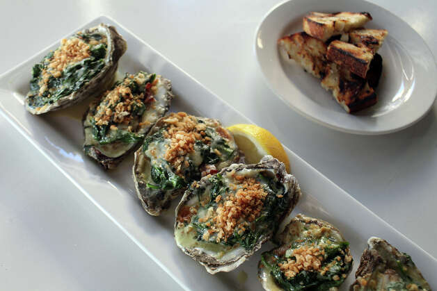 A half dozen Oysters Rockefeller, made with seasonal Texas Gulf oysters, at Knife & Fork Gastropub in San Antonio on Tuesday, August 14, 2012. Photo: Lisa Krantz, San Antonio Express-News / San Antonio Express-News