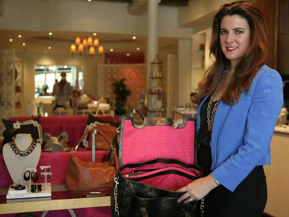 Handbag and shoe designer Elaine Turner shows the signature hot pink lining  in all of her handbags at her a new store  in Alamo Heights Thursday August 2, 2012. Photo: Julysa Sosa / SAN ANTONIO EXPRESS-NEWS