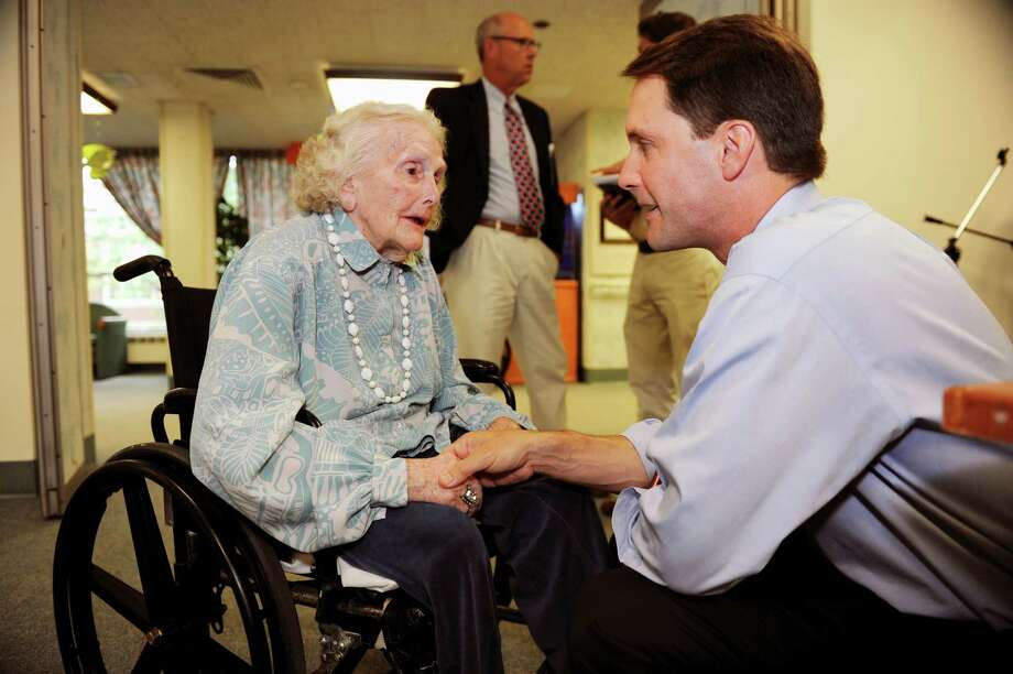 Nathaniel Witherell resident Nan Dernier speaks with U.S. Rep. Jim Himes, D-Conn., Wednesday, Aug. 15, 2012. Himes joined residents and staff for a tour of the Nathaniel Witherell short-term rehabilitation and skilled nursing center. Photo: Helen Neafsey / Greenwich Time