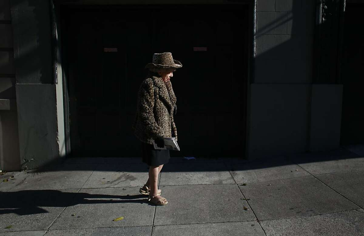 One half of the famed San Francisco twins, Marion Brown, 85, walks home walks home to the apartment on Pine Street on Monday Aug, 13, 2012 in San Francisco, Calif. where she and her sister Vivian have lived for 30 years. Vivian Brown has fallen ill and has been in the hospital for the past month.