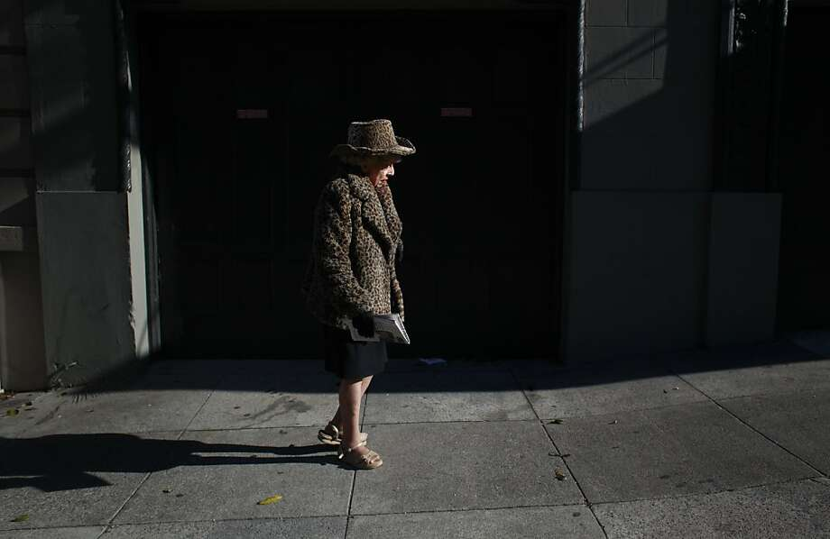 Marian Brown walks to her Nob Hill apartment where she used to care for her twin sister Vivian until a fall a month ago. Photo: Mike Kepka, The Chronicle