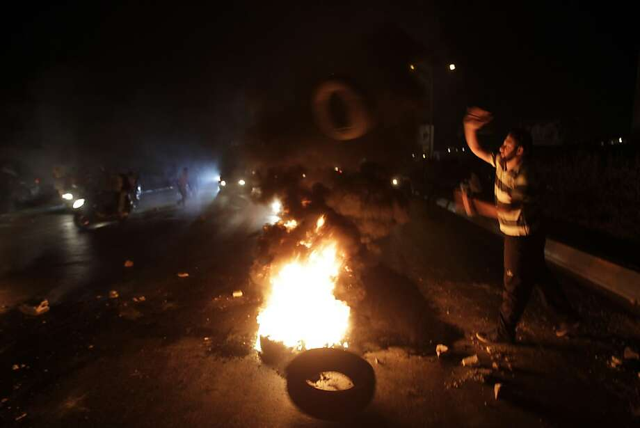 Tires burn in protest as Lebanese relatives of those abducted by Syrian rebels block the road leading to Beirut's airport. Photo: Anwar Amro, AFP/Getty Images