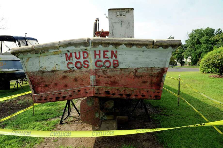 A derelict boat named the Mudhen, located on town property at the Cos Cob Marina, is scheduled to be destroyed Thursday, Aug. 16, 2012, because of safety concerns. Photo: Helen Neafsey / Greenwich Time