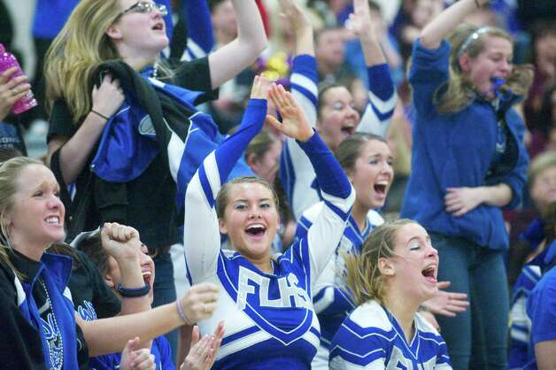 Fairfield Ludlowe High School's Allie Meyer, center, reacts to her teammates successful stunt performance in the FCIAC Cheerleading Championships in Wilton, Conn., Sunday February 6, 2011. Photo: Keelin Daly, ST / Stamford Advocate