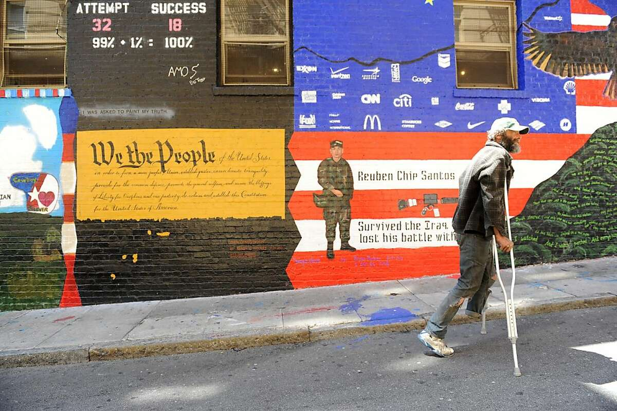 Army veteran Pete Skelley walks down Veteran's Alley (also known as Shannon) on Wednesday, August 15, 2012. Dozens of military veterans have spent the summer painting murals on walls in the alley off Geary Street in the Tenderloin. The idea of the murals is to honor the 4,000-plus servicemen and women who have died in Iraq.