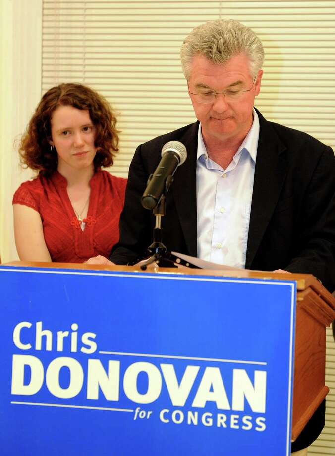 Connecticut House Speaker Chris Donovan reacts after losing the Democratic nomination in the 5th Connecticut Congressional District as his daughter Sarah looks on. Donovan spoke to supporters after conceding at the Curtis Cultural center in Meriden, Conn., on Tuesday, Aug. 14, 2012. Photo: Fred Beckham, Fred Beckham/Associated Press / Associated Press