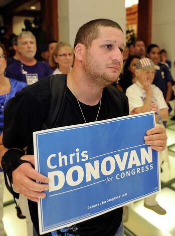 Pablo Cardona Serrano, of Meriden, reacts to Chris Donovan's concession speech in Meriden, Conn., after losing his primary race in the 5th congressional district of Connecticut,  on Tuesday, Aug. 14, 2012. Serrano visited the Curtis Cultural center to watch the results. Photo: Fred Beckham, Fred Beckham/Associated Press / Associated Press