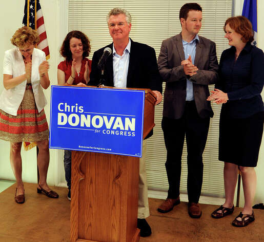 Connecticut House Speaker Chris Donovan reacts after losing the Democratic nomination in the 5th Connecticut Congressional District as his family looks on, at the Curtis Cultural center in Meriden, Conn., on Tuesday, Aug. 14, 2012. Photo: Fred Beckham, Fred Beckham/Associated Press / Associated Press