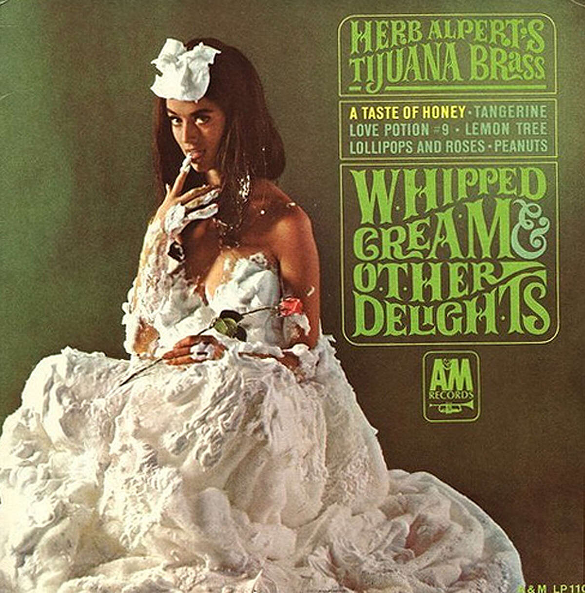 """""""Whipped Cream and Other Delights"""" by Herb Alpert and the Tijuana Brass has reportedly sold more than 6 million copies since its release in 1965. Dolores Erickson, a Seattle native and Cleveland High School graduate who attended the University of Washington, was the cover model. During concerts, Alpert used to tell crowds, """"""""Sorry, we can't play the cover for you!"""""""