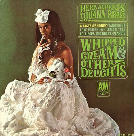 """Whipped Cream and Other Delights"" by Herb Alpert and the Tijuana Brass has reportedly sold more than 6 million copies since its release in 1965. Dolores Erickson, a Seattle native and Cleveland High School graduate who attended the University of Washington, was the cover model. During concerts, Alpert used to tell crowds, """"Sorry, we can't play the cover for you!"" Photo: Album Cover"