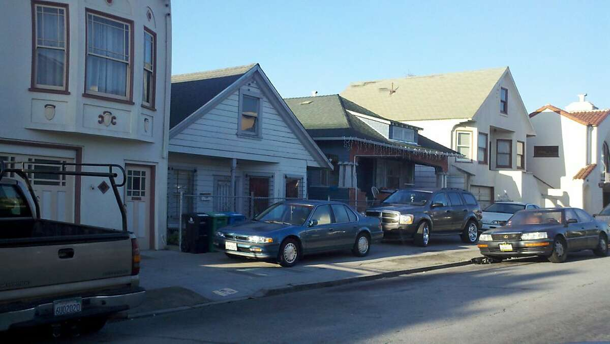 Cars parked on the sidewalk in the Bayview district of San Francisco.
