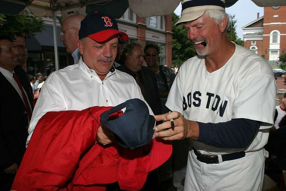 Former Boston Red Sox pitcher Bill Lee, right, autographs a baseball hat for Burlington, Vt., Mayor Peter Clavelle, left, on Church Street Marketplace in Burlington, Vt., Thursday, Aug. 7, 2003, as Vermont Gov. Jim Douglas declared it Red Sox Day in Vermont. About 600 people gathered for the event. (AP Photo/Alden Pellett) Photo: Alden Pellett, ASSOCIATED PRESS
