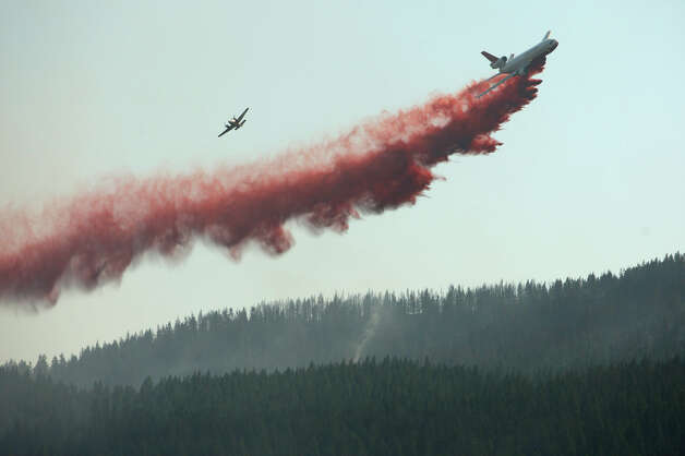 A DC-10 drops fire retardant on a hillside along Highway 970 near Swauk Prarie Road on Wednesday, August 15, 2012. The Taylor Bridge Fire has forced hundreds to evacuate and has burned dozens of homes. Photo: JOSHUA TRUJILLO / SEATTLEPI.COM