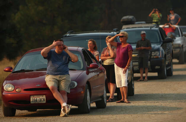 Evacuees and spectators watch the Taylor Bridge Fire erupt near Highway 970, south of Swauk Prairie Road on Wednesday, August 15, 2012. The Taylor Bridge Fire has forced hundreds to evacuate and has burned dozens of homes. Photo: JOSHUA TRUJILLO / SEATTLEPI.COM