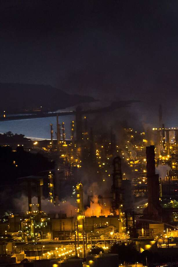 The August fire at the Chevron refinery sends black smoke billowing across the surrounding area. Photo: John Sebastian Russo, Special To The Chronicle
