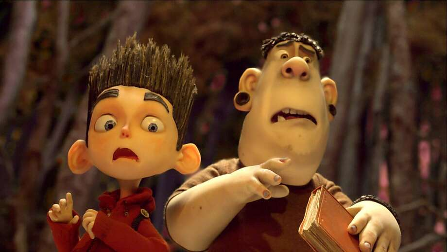 "Norman (Kodi Smit-McPhee, left) and Alvin (Christopher Mintz-Plasse) fight off zombies in ""ParaNorman."" Photo: Associated Press"