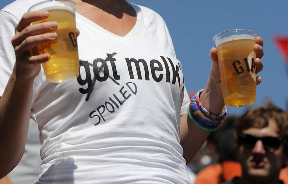 "Brandy Gibb, of Walnut Creek, wears her ""spoiled Melky"" t-shirt as she gets some beers as the San Francisco Giants played the Washington Nationals at AT&T Park in San Francisco, Calif., on Wednesday, August 15, 2012. MLB announced the suspension of Melky Cabrera earlier in the day, leaving the Giants without one of their best offensive players and the Giants lost to the Nationals 6-4. Photo: Carlos Avila Gonzalez, The Chronicle"