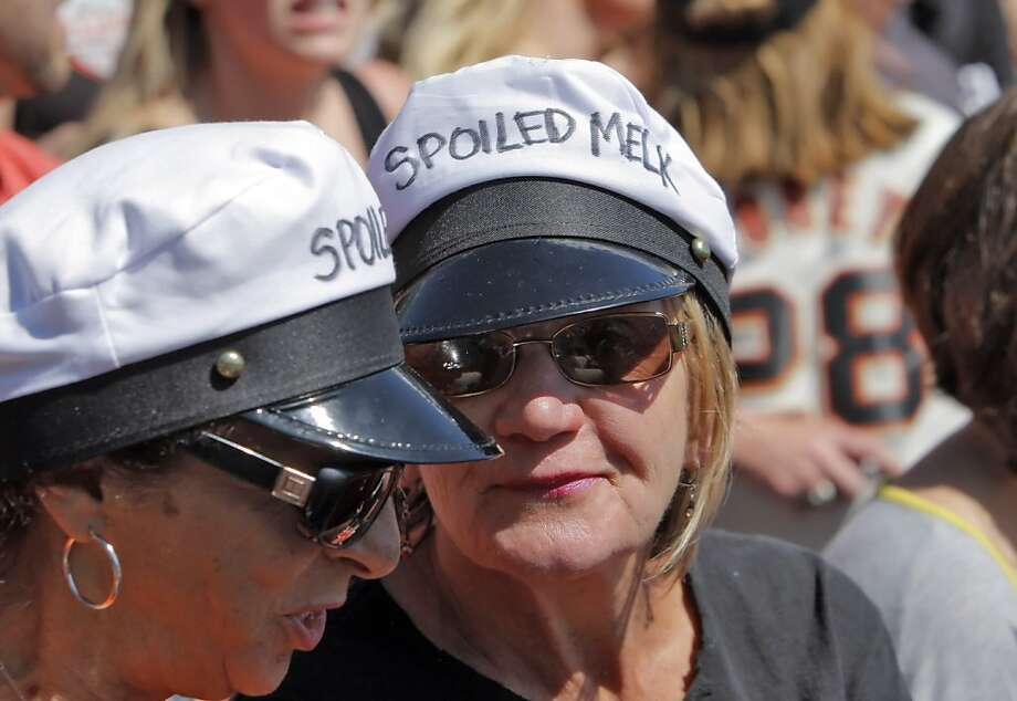"Cathy Chavez-Miller, left, and Maryanne Paul of Watsonville, wear Milk man hats reading ""spoiled Melky"" referring to Melky Cabrera's suspension for testing positive for testosterone use. The San Francisco Giants played the Washington Nationals at AT&T Park in San Francisco, Calif., on Wednesday, August 15, 2012. MLB announced the suspension of Melky Cabrera earlier in the day, leaving the Giants without one of their best offensive players and the Giants lost to the Nationals 6-4. Photo: Carlos Avila Gonzalez, The Chronicle"