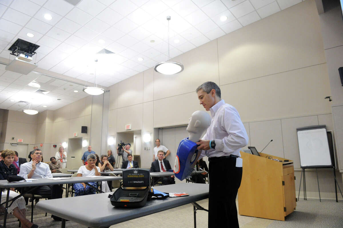 """Dr. Thomas Nero conducts a training session for the upcoming Hands for Life event at the Tully Center in Stamford, Conn., August 15, 2012. Hands for Life will take place at Chelsea Piers Saturday, August 25 The goal for the event is to train 10,000 people how to provide cardiopulmonary resuscitation. Earlier in the evening, State Rep. Gerald Fox was given the first """"Hands for Life"""" award for his long time support of """"Good Samaritan"""" laws to indemnify those who administer CPR."""