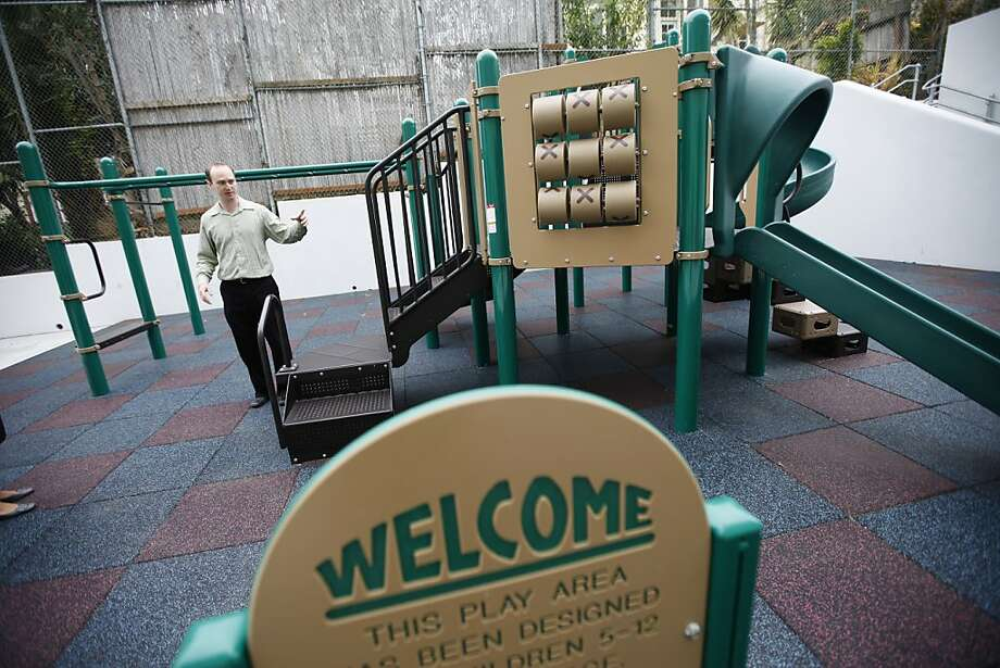 Ryan Henderson, project manager, checks out the new play structure outside the Chinese Immersion School at DeAvila, among the last schools to complete the access work. Photo: Sonja Och, The Chronicle