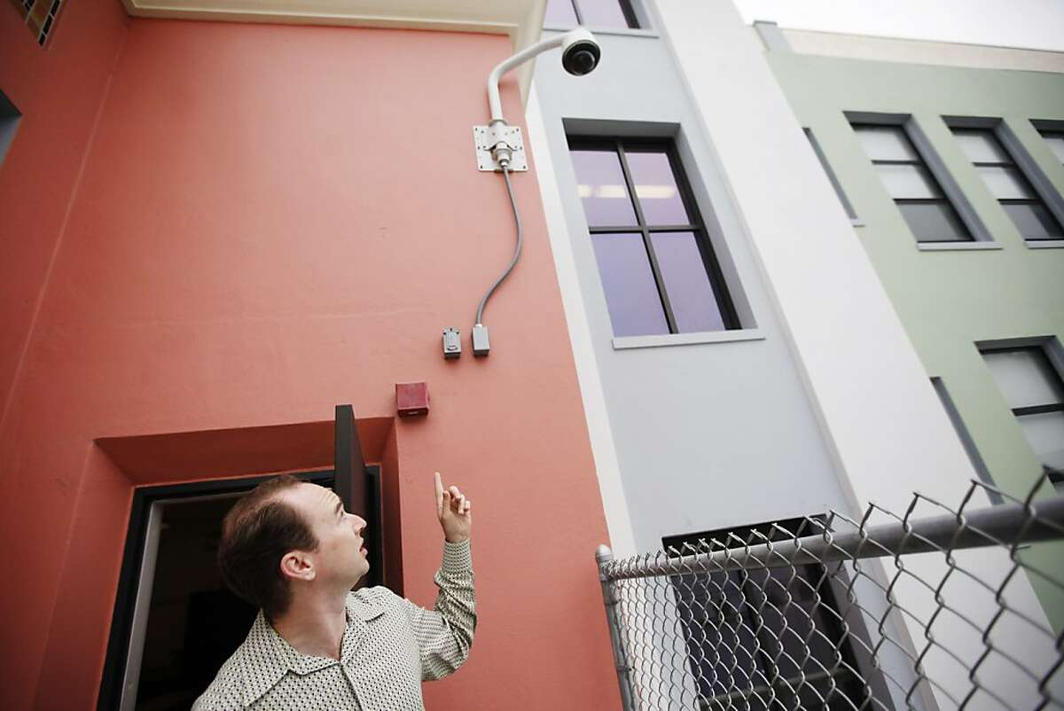 Ryan D. Henderson, Sr. Project Manager, points out the new security cameras outside the DeAvila school in San Francisco, Calif. on Wednesday, Aug 15, 2012.