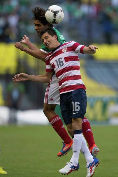 USA 1, Mexico 0 ... Manuel Viniegra of Mexico fights for the ball with Jose Torres of the Uni