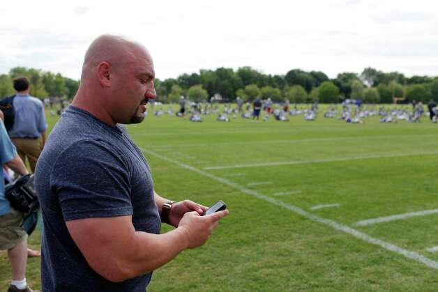 Jay Glazer uses his phone on the sidelines of New York Giants preseason training camp at UAlbany on Monday Aug. 13, 2012 in Albany, N.Y. (Dan Little/Special to the Times Union) Photo: Dan Little / Copyright: All Rights Reserved Brett Carlsen