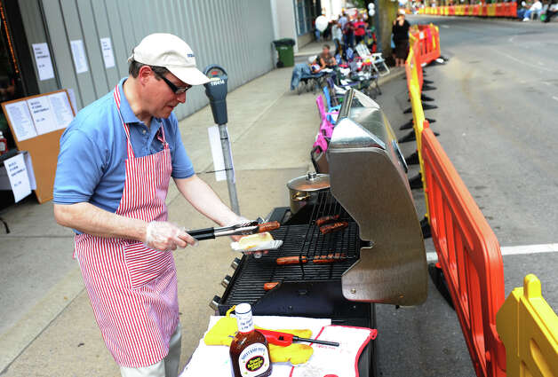 Business owner Francis Ciccarelli serves up hot dogs to people before the start of a parade down Third Street that was held to kick off the 2012 Little League World Series in Williamsport, Penn. on Wednesday August 15, 2012. Photo: Christian Abraham / Connecticut Post