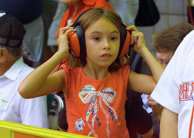 Savannah Watts, 7, of Williamsport, puts on ear protectors during a parade down Third Street that was held to kick off the 2012 Little League World Series in Williamsport, Penn. on Wednesday August 15, 2012. Photo: Christian Abraham / Connecticut Post