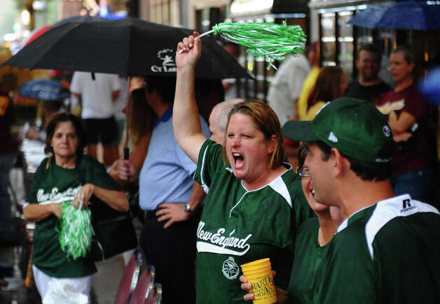 New Egland team mom Alli Lucas cheers during  a parade down Third Street which was held to kick off the 2012 Little League World Series in Williamsport, Penn. on Wednesday August 15, 2012. Alli's husband John in the coach and her son Will plays on the team. Photo: Christian Abraham / Connecticut Post