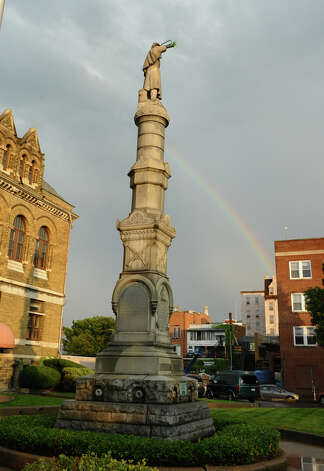 A rainbow is in the sky near city hall after downpours swept through during a parade down Third Street which was held to kick off the 2012 Little League World Series in Williamsport, Penn. on Wednesday August 15, 2012. Photo: Christian Abraham / Connecticut Post