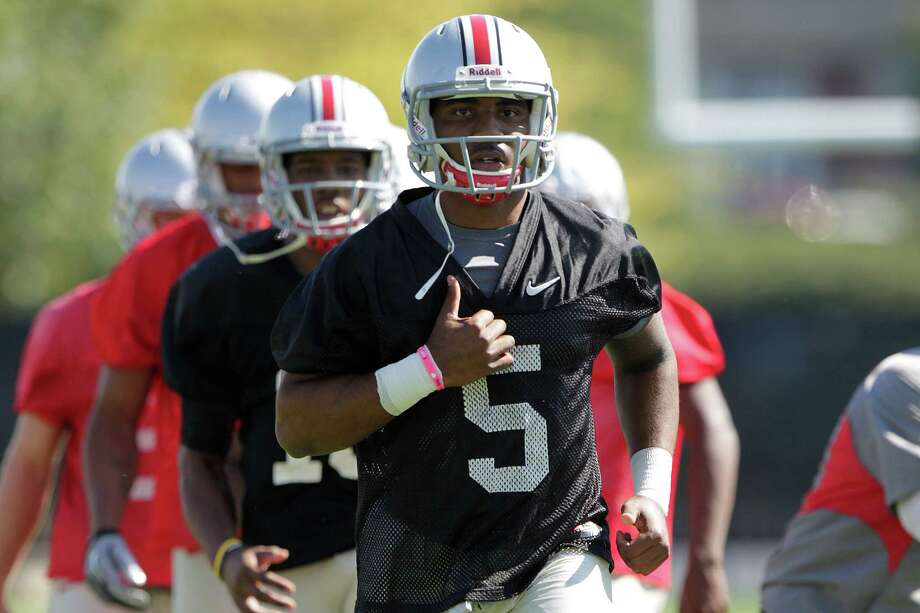 Quarterback Braxton Miller will be asked to run Urban Meyer's new spread offense. Photo: Jay LaPrete, Associated Press / FR52593 AP