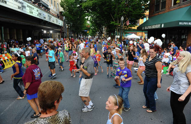 Spectators take part in a line dance before the start of a parade down Third Street which was held to kick off the 2012 Little League World Series in Williamsport Photo: Christian Abraham / Connecticut Post