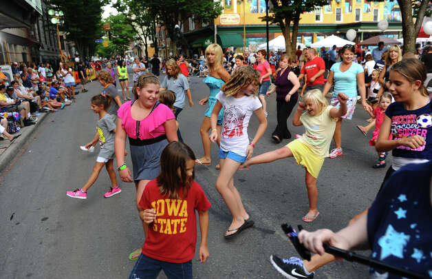 Spectators take part in a line dance before the start of a parade down Third Street which was held to kick off the 2012 Little League World Series in Williamsport, Penn. on Wednesday August 15, 2012. Photo: Christian Abraham / Connecticut Post