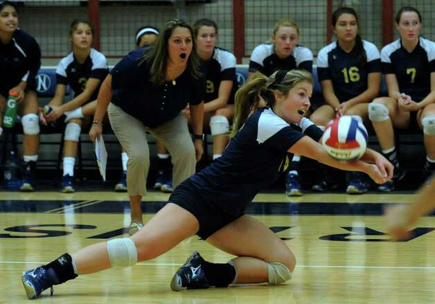 O'Connor's Kristin Fording saves the ball as coach Yamilet Garcia watches during high school volleyball action against Reagan at O'Connor High School on Wednesday, Aug. 15, 2012. Photo: Billy Calzada, San Antonio Express-News / © San Antonio Express-News