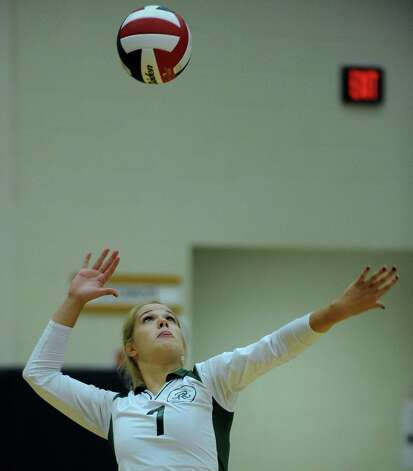 Bailey Shurbert of Reagan serves against O'Connor during high school volleyball on Wednesday, Aug. 15, 2012. Photo: Billy Calzada, San Antonio Express-News / © San Antonio Express-News