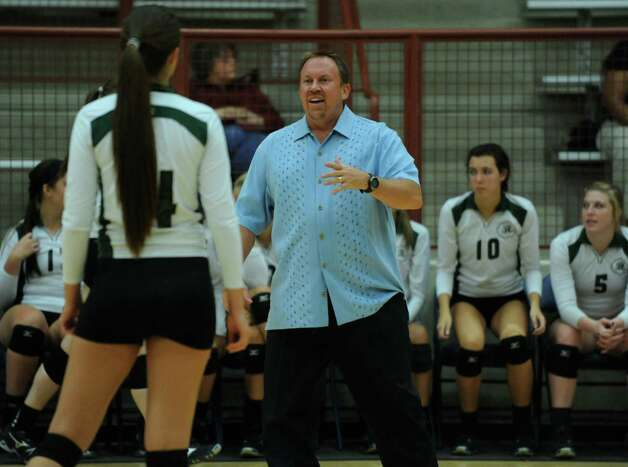 Reagan coach Mike Carter talks with Morgan Reed during action against O'Connor at O'Connor High School on Wednesday, Aug. 15, 2012. Photo: Billy Calzada, San Antonio Express-News / © San Antonio Express-News