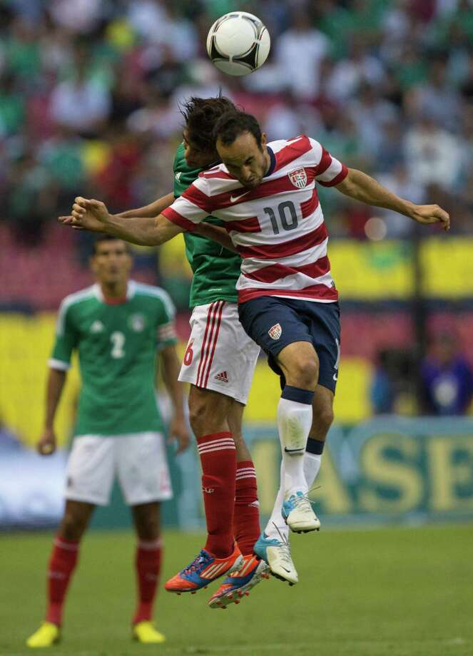 Manuel Viniegra of Mexico fights for the ball with Landon Donovan of the United States. Photo: Miguel Tovar, Getty Images / 2012 Getty Images