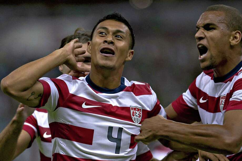 Michael Orozco (L) of USA celebrates a goal against Mexico during a friendly football match at the Azteca stadium in Mexico City on August 15, 2012. AFP PHOTO/MEXSPORT - ROBERTO MAYAROBERTO MAYA/AFP/GettyImages Photo: ROBERTO MAYA, AFP/Getty Images / MEXSPORT