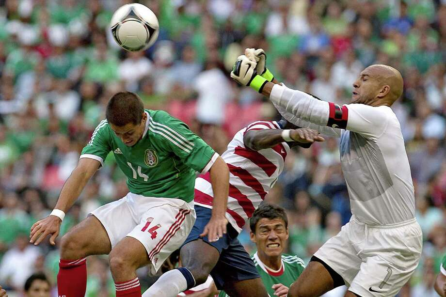 Javier Hernandez (L) of Mexico jumps for the ball with USA goalkeeper Tim Howard during a friendly football match at the Azteca stadium in Mexico City on August 15, 2012. AFP PHOTO/MEXSPORT - ROBERTO MAYAROBERTO MAYA/AFP/GettyImages Photo: ROBERTO MAYA, AFP/Getty Images / AFP