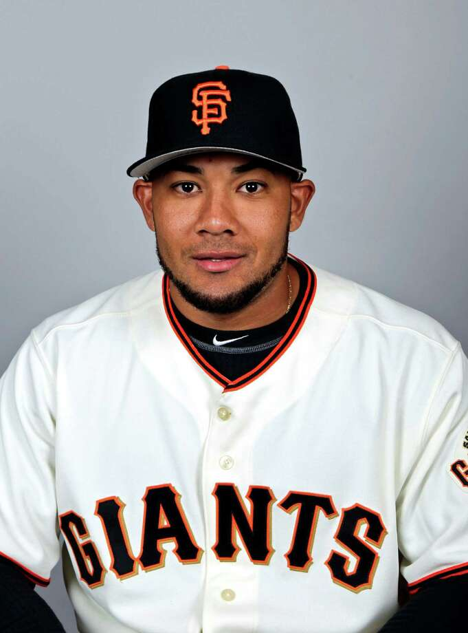 FILE - This March 1, 2012 file photo shows San Francisco Giants baseball player Melky Cabrera. Cabrera has been suspended for 50 games without pay after testing positive for testosterone. The commissioner's office says the suspension is effective immediately. Major League Baseball said on Wednesday, Aug. 15, 2012,  that Cabrera tested positive for the banned performance-enhancing substance, which violates MLB's joint drug prevention and treatment program. (AP Photo/Morry Gash, File) Photo: Morry Gash / MLBPV AP
